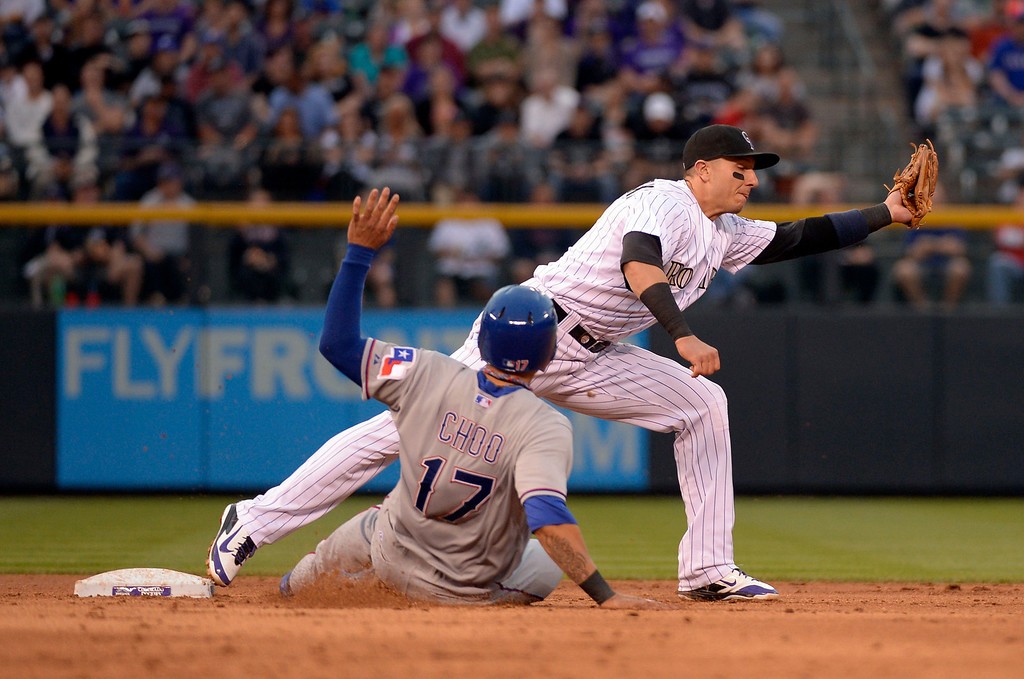 . DENVER, CO - MAY 06: Colorado Rockies shortstop Troy Tulowitzki (2) stretches out for the ball as Texas Rangers left fielder Shin-Soo Choo (17) is forced at second during the 3rd inning May 6, 2014 at Coors Field. (Photo by John Leyba/The Denver Post)