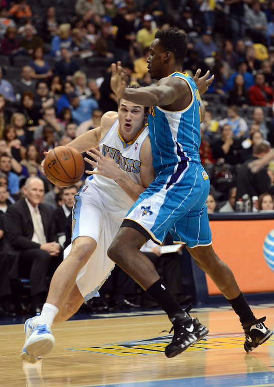 . DENVER, CO. - FEBRUARY 01: Danilo Garllinari of Denver Nuggets #8 drives against Al-Farouq Aminu of New Orleans Hornets in the 2nd half of the game on February 1, 2013 at the Pepsi Center in Denver, Colorado. Denver won 113-98. (Photo By Hyoung Chang/The Denver Post)