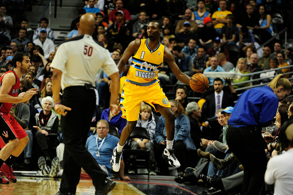 . Denver Nuggets small forward Jordan Hamilton (1) saves a loose ball against the Toronto Raptors during the second half of the Nuggets\' 113-110 win at the Pepsi Center on Monday, December 3, 2012. AAron Ontiveroz, The Denver Post