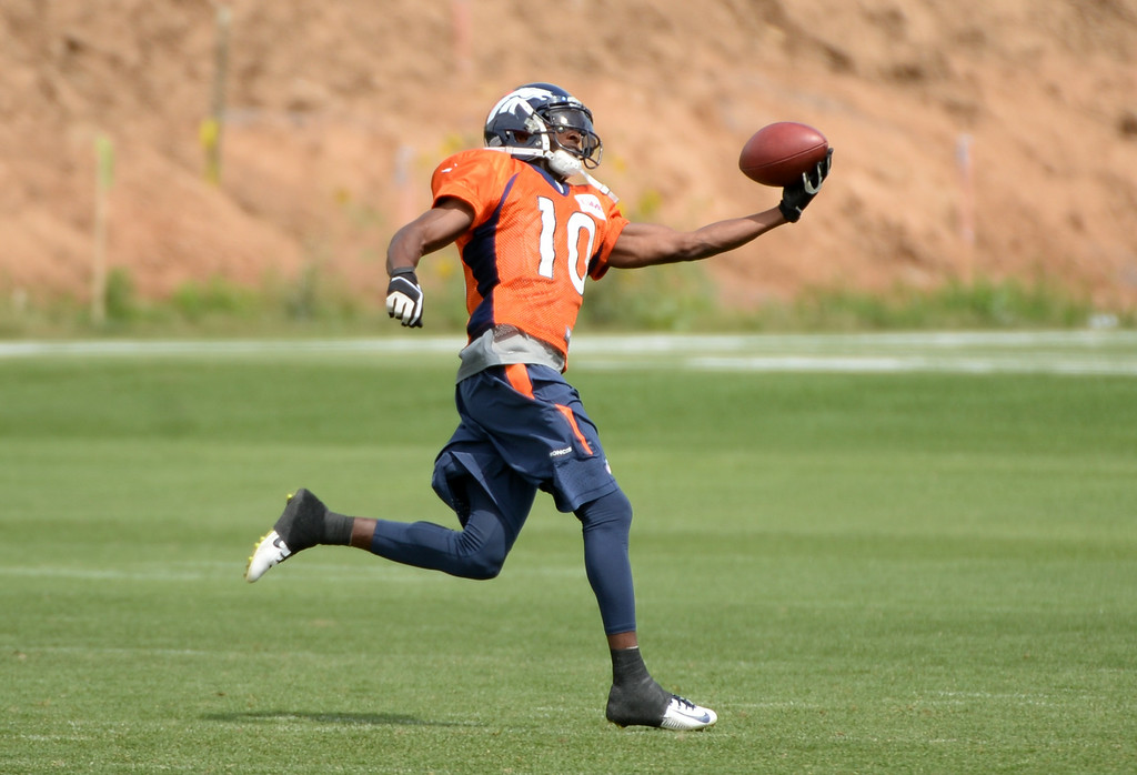 . Emmanuel Sanders of Denver Broncos (10) catches the ball during the Denver Broncos 2014 training camp at Dove Valley, Englewood, Colorado, August 01, 2014. (Photo by Hyoung Chang/The Denver Post)