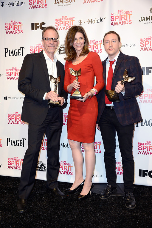. SANTA MONICA, CA - FEBRUARY 23:  (L-R) Director Kirby Dick and producers Amy Ziering and Tanner King Barklow pose with the Best Documentary award for \'The Invisible War\' in the press room during the 2013 Film Independent Spirit Awards at Santa Monica Beach on February 23, 2013 in Santa Monica, California.  (Photo by Frazer Harrison/Getty Images)