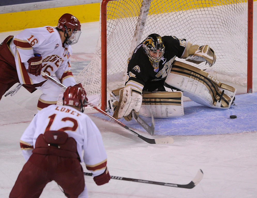 . DENVER, CO. - NOVEMBER 16: Denver left wing Zac Larraza (16) slipped a shot through the crease in front of Western Michigan goaltender Lukas Hafner in the first period. The University of Denver hockey team hosted Western Michigan at Magness Arena Saturday night, November 16, 2013.  Photo By Karl Gehring/The Denver Post