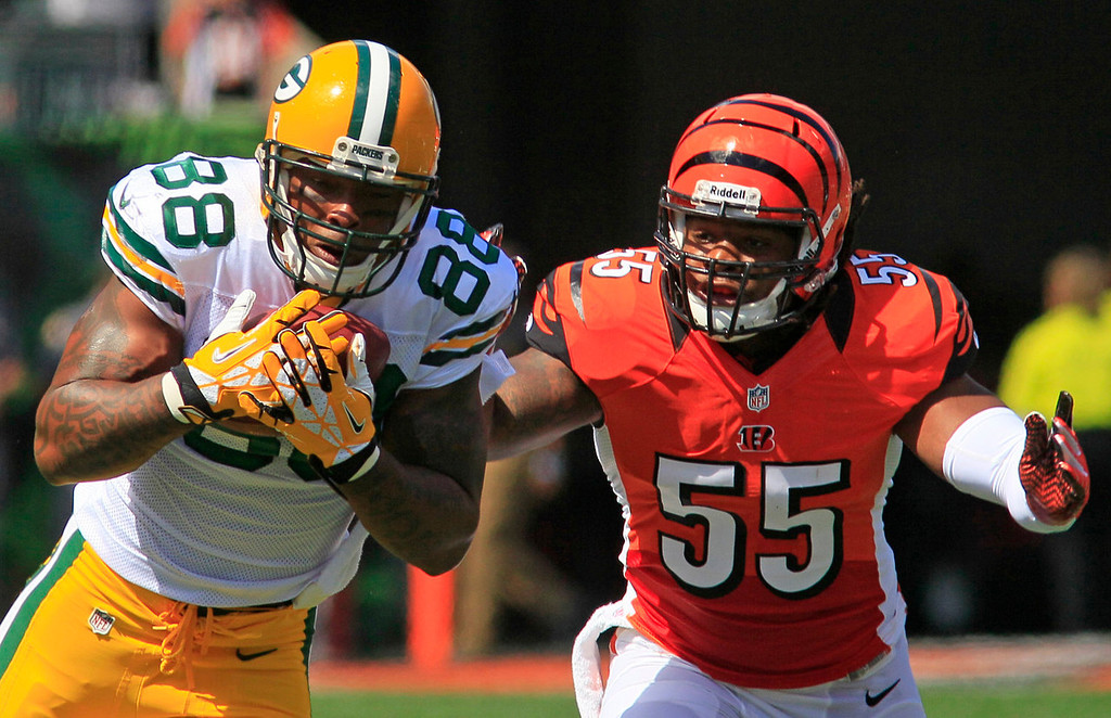. Green Bay Packers tight end Jermichael Finley (88) catches a pass against Cincinnati Bengals outside linebacker Vontaze Burfict (55) in the first half of an NFL football game, Sunday, Sept. 22, 2013, in Cincinnati. (AP Photo/Tom Uhlman)