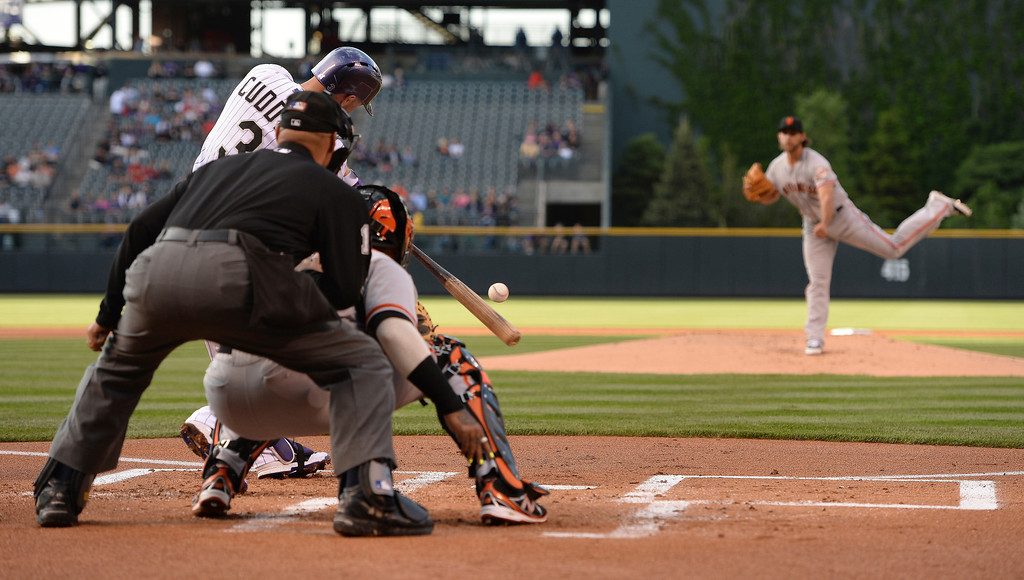 . Colorado batter Michael Cuddyer fouled off a pitch from San Francisco starter Madison Bumgarner in the first inning.   (Photo by Karl Gehring/The Denver Post)
