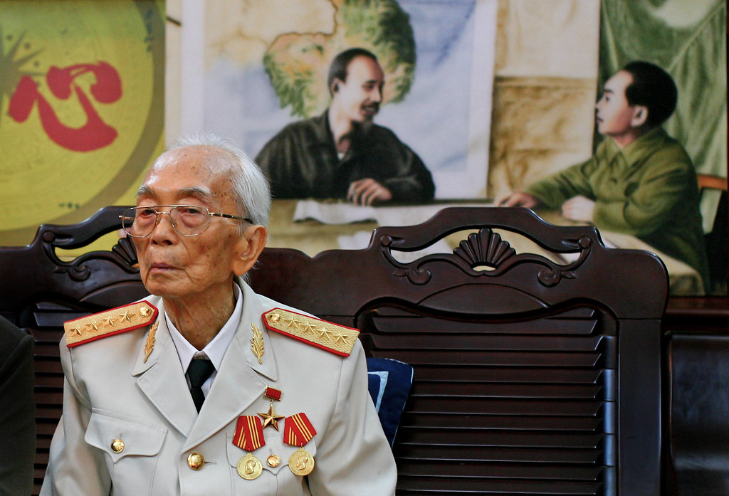 . Vietnamese General Vo Nguyen Giap is seen in front of a painting of himself and president Ho Chi Minh, left, at his home in Hanoi, Vietnam in this picture made  Aug. 25 2008, his 97th birthday. Officials say Giap, the military mastermind who drove the French and the Americans out of Vietnam, has died at age 102. He was the country\'s last famous communist revolutionary, and used ingenious guerrilla tactics to overcome enormous odds against superior forces.   (AP Photo/Na Son Nguyen, file)