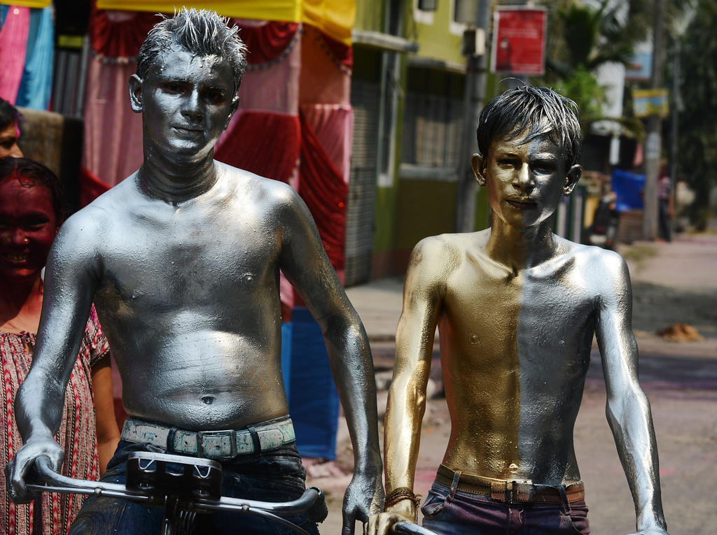 . Indian revelers painted in metallic paints pose for a photograph during Holi festival celebrations in Siliguri on March 17, 2014. Holi, also called the Festival of Colors, is a popular Hindu spring festival observed in India at the end of the winter season on the last full moon day of the lunar month.AFP PHOTO /Diptendu  DUTTA/AFP/Getty Images