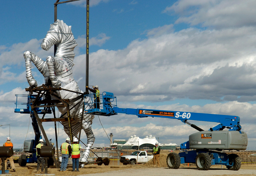 ". The Luis Jimenez ""Mustang\"" sculpture arrives and is erected at Denver International Airport on Monday, Feb. 11, 2008. Kathryn Scott Osler, The Denver Post"