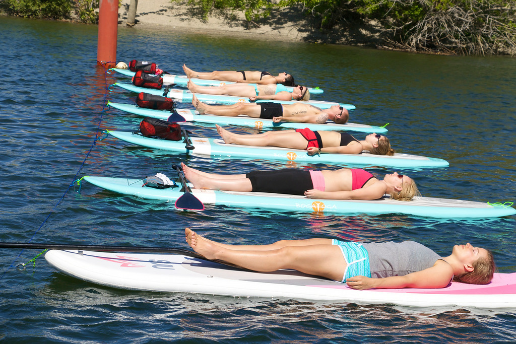 . Students during an iLaYoga stand-up paddle board class on the Columbia River in Wenatchee.  (Photo provided by iLaYoga.com)