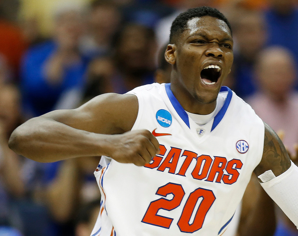 . Florida guard Michael Frazier II (20) celebrates a goal against UCLA during the second half in a regional semifinal game at the NCAA college basketball tournament, Thursday, March 27, 2014, in Memphis, Tenn. Florida won 79-68. (AP Photo/John Bazemore)