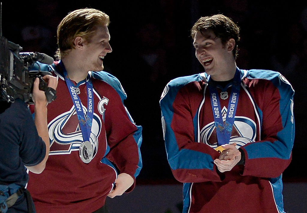 . Colorado Avalanche left wing Gabriel Landeskog (92) (L) and Colorado Avalanche center Matt Duchene (9) smile after they were announced as silver and gold medalists in the 2014 Sochi Games before their game against the Los Angeles Kings February 27, 2014 at Pepsi Center. (Photo by John Leyba/The Denver Post)