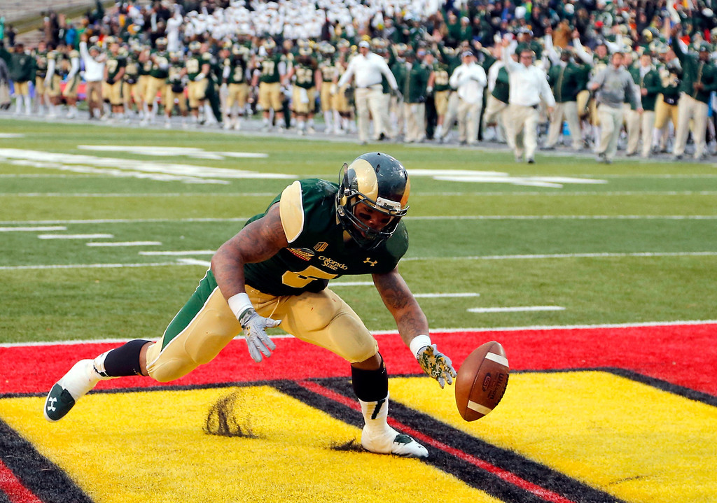 . Colorado State running back Kapri Bibbs (5) recovers his fumble for a touchdown against Washington State during the second half of the NCAA New Mexico Bowl college football game, Saturday, Dec. 21, 2013, in Albuquerque, N.M. Colorado State won 48-45.(AP Photo/Matt York)