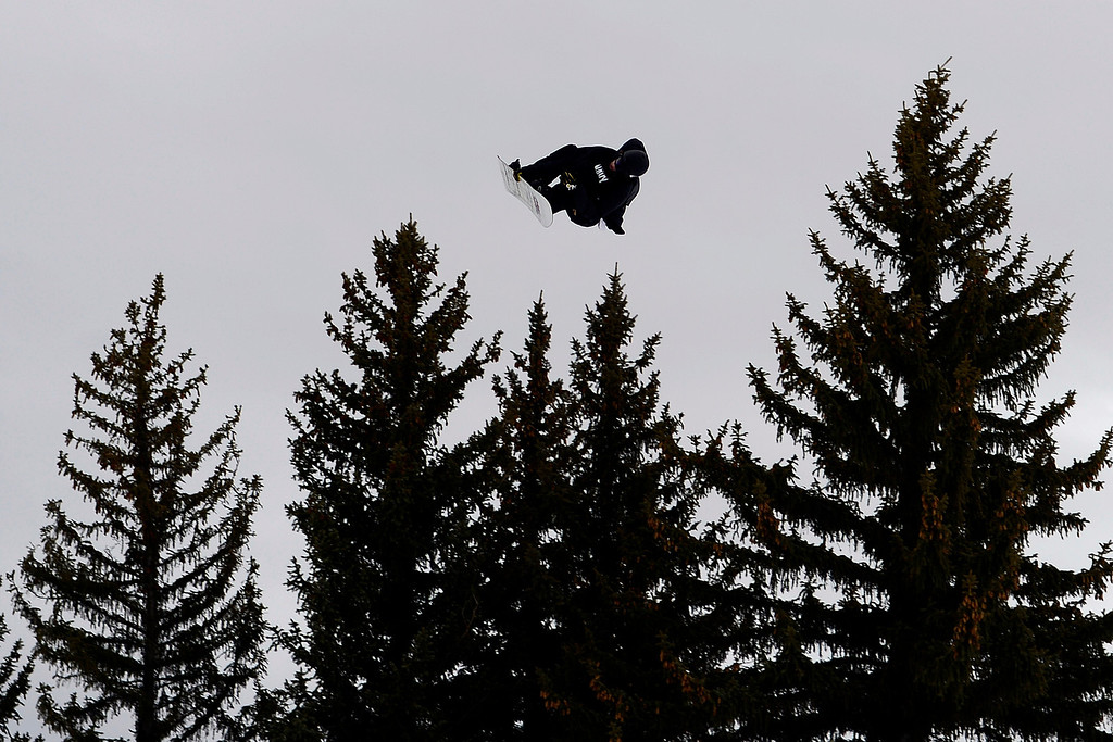 . ASPEN, CO - JANUARY 26: Seppe Smits clears the trees during the men\'s snowboard slopestyle final. X Games Aspen Buettermilk Mountain Aspen January 26, 2013 (Photo By AAron Ontiveroz / The Denver Post)