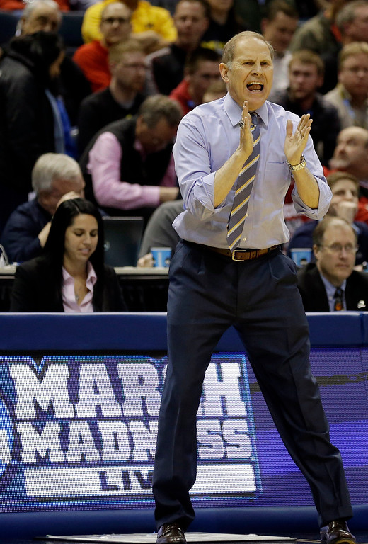 . Michigan head coach John Beilein directs his team during the first half of a second round NCAA college basketball tournament game against the Wofford Thursday, March 20, 2014, in Milwaukee. (AP Photo/Jeffrey Phelps)