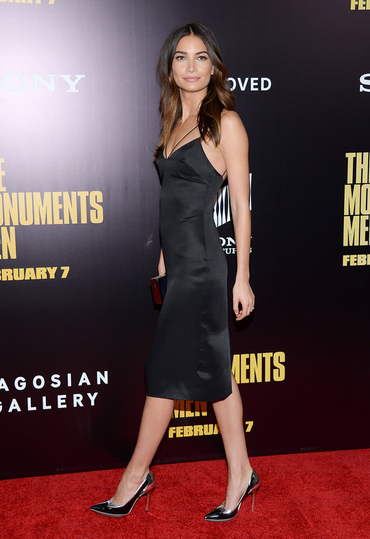 """. Model Lily Aldridge attends the premiere of \""""The Monuments Men\"""" at the Ziegfeld Theatre on Tuesday, Feb. 4, 2014, in New York.  (Photo by Evan Agostini/Invision/AP)"""