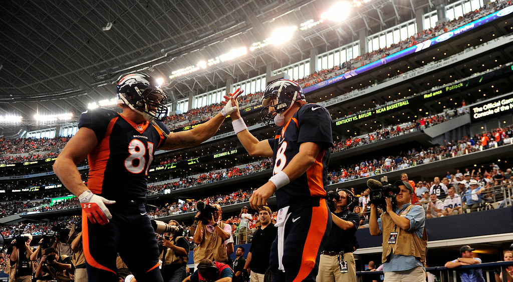 . Peyton Manning, right, high-fives Joel Dreessen after rushing for a touchdown against the Cowboys. (AAron Ontiveroz/The Denver Post)