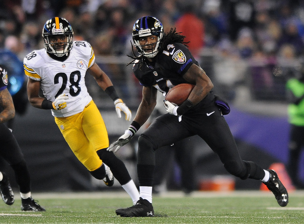 . Baltimore Ravens wide receiver Marlon Brown (14) rushes the ball past Pittsburgh Steelers cornerback Cortez Allen in the second half of an NFL football game on Thursday, Nov. 28, 2013, in Baltimore. (AP Photo/Gail Burton)