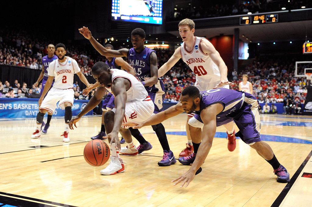 . DAYTON, OH - MARCH 22: Victor Oladipo #4 of the Indiana Hoosiers and A.J. Davis #0 of the James Madison Dukes go for a loose ball in the first half during the second round of the 2013 NCAA Men\'s Basketball Tournament at UD Arena on March 22, 2013 in Dayton, Ohio.  (Photo by Jason Miller/Getty Images)