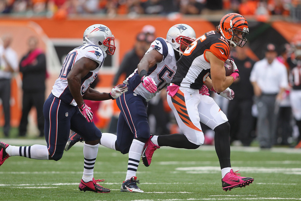 . Tyler Eifert #85 of the Cincinnati Bengals runs the ball upfield during the game against the New England Patriots at Paul Brown Stadium on October 6, 2013 in Cincinnati, Ohio.  (Photo by John Grieshop/Getty Images)