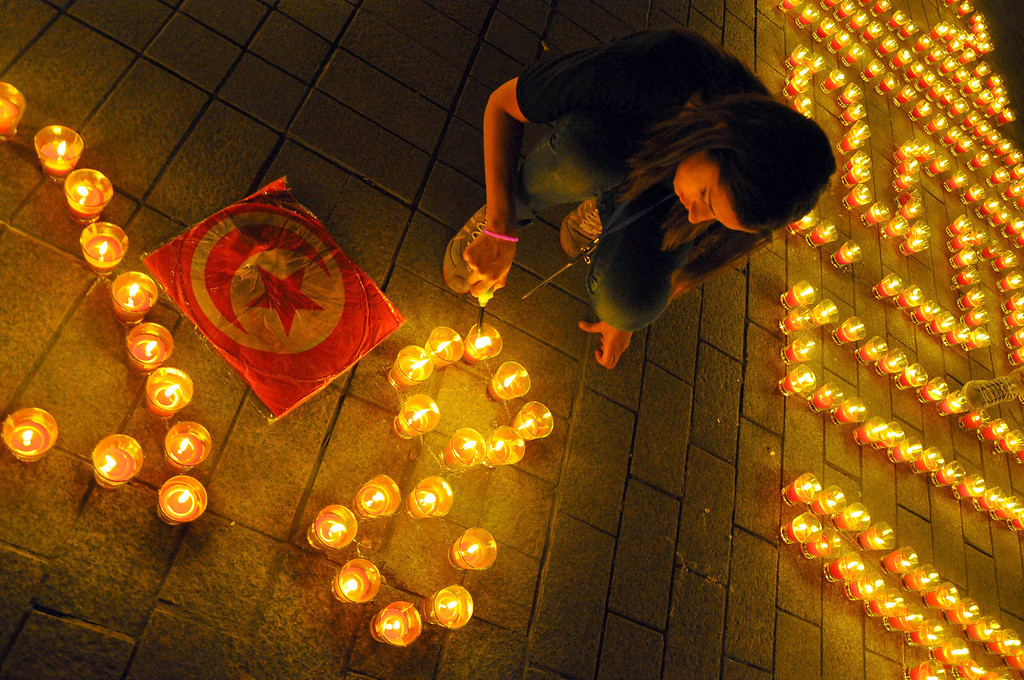 ". This picture shows a woman lighting candles arranged to read ""Tunisia\"" in the Habib Bourguiba avenue after submerging into darkness as part of the Earth Hour switch-off in Tunis on March 23, 2013. Organisers expect hundreds of millions of people across more than 150 countries to turn off their lights for 60 minutes on Saturday night -- at 8:30 pm local time -- in a symbolic show of support for the planet. While more than 150 countries joined in last year\'s event, the movement has spread even further afield this year, with Palestine, Tunisia, Suriname and Rwanda among a host of newcomers pledging to take part. Isafa laamiri/AFP/Getty Images"