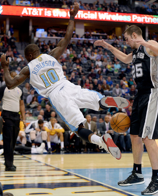 . DENVER, CO - OCTOBER 14: ,d10 gets shoved out of bounds by San Antonio Spurs point guard Nando de Colo (25) during the fourth quarter  October 14, 2013 at Pepsi Center. (Photo By John Leyba/The Denver Post)