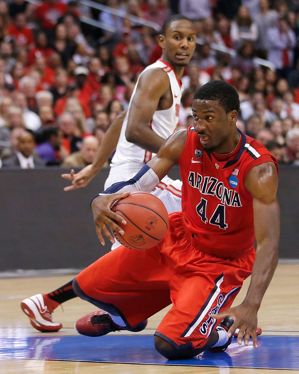 . Arizona\'s Solomon Hill hangs on to the ball as Ohio State forward Sam Thompson, rear, watches during the second half of a West Regional semifinal in the NCAA men\'s college basketball tournament, Thursday, March 28, 2013, in Los Angeles. (AP Photo/Jae C. Hong)