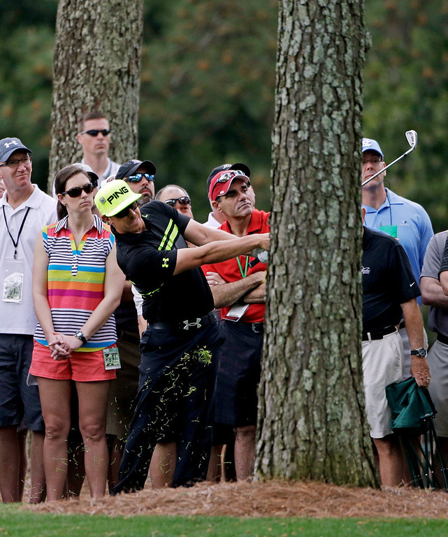 . Hunter Mahan hits out of the rough off the first fairway during the second round of the Masters golf tournament Friday, April 12, 2013, in Augusta, Ga. (AP Photo/Darron Cummings)