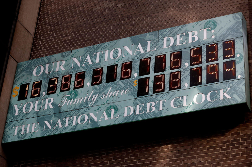 . A sign showing the U.S. national debt is displayed in New York, Monday, Dec. 31, 2012. Working against a midnight deadline, negotiators for the White House and congressional Republicans narrowed their differences Monday on legislation to avert across-the-board tax increases. (AP Photo/Seth Wenig)