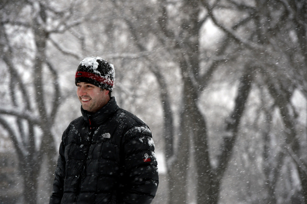 . BOULDER, CO- FEBRUARY 19:  Josh East plays with his dog Huck in Washington Park on February 20, 2013.  Snow hit the Denver metro area around 2:30 with forecasters calling for  2-4 inches in Denver more to the South and East.  (Photo By Helen H. Richardson/ The Denver Post)
