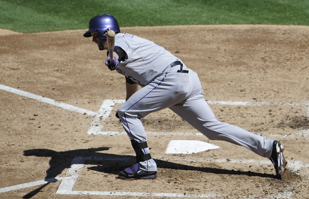 . Michael Cuddyer #3 of the Colorado Rockies hits an RBI  double during the third inning of a baseball game against the San Diego Padres at Petco Park on September 8, 2013 in San Diego, California.  (Photo by Denis Poroy/Getty Images)