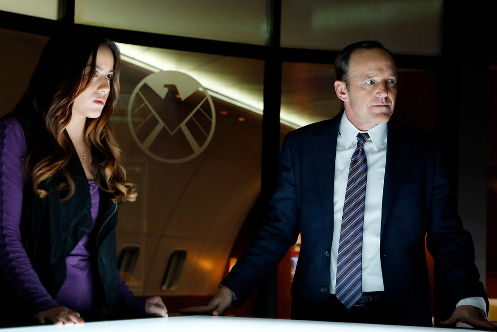 ". MARVEL\'S AGENTS OF S.H.I.E.L.D. - ""Pilot\"" - Joss Whedon, the creative genius behind the feature film \""Marvel\'s The Avengers,\"" one of the highest grossing films of all time, and of the iconic television series \""Buffy The Vampire Slayer,\"" has co-created \""Marvel\'s Agents of S.H.I.E.L.D.,\"" a dynamic, action-packed one-hour drama that brings back Agent Phil Coulson (Clark Gregg) to lead a team of highly skilled agents to investigate extra-normal and super human people and events worldwide.  (ABC/Justin Lubin) CHLOE BENNET, CLARK GREGG"