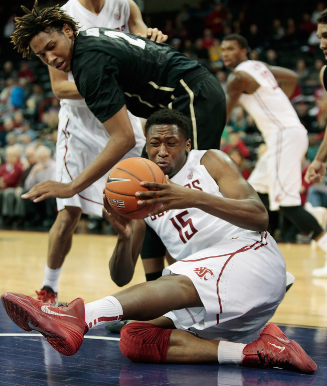 . Junior Longrus #15 of the Washington State Cougars grabs a loose ball in the second half against the Colorado Buffaloes at Spokane Arena on January 8, 2014 in Spokane, Washington.  (Photo by William Mancebo/Getty Images)