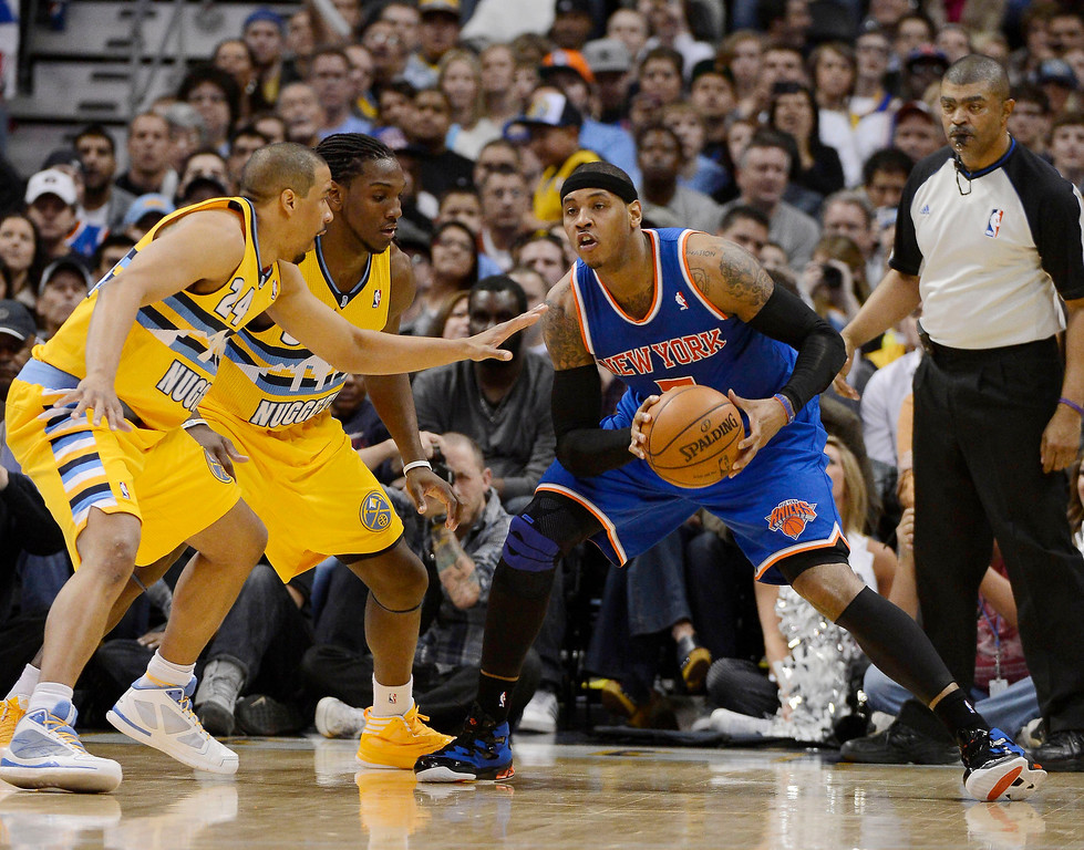 . Carmelo Anthony (7) of the New York Knicks gets doubled teamed by Andre Miller (24) of the Denver Nuggets and Kenneth Faried (35) of the Denver Nuggets durig the second quarter March 13,  2013 at Pepsi Center. (Photo By John Leyba/The Denver Post)