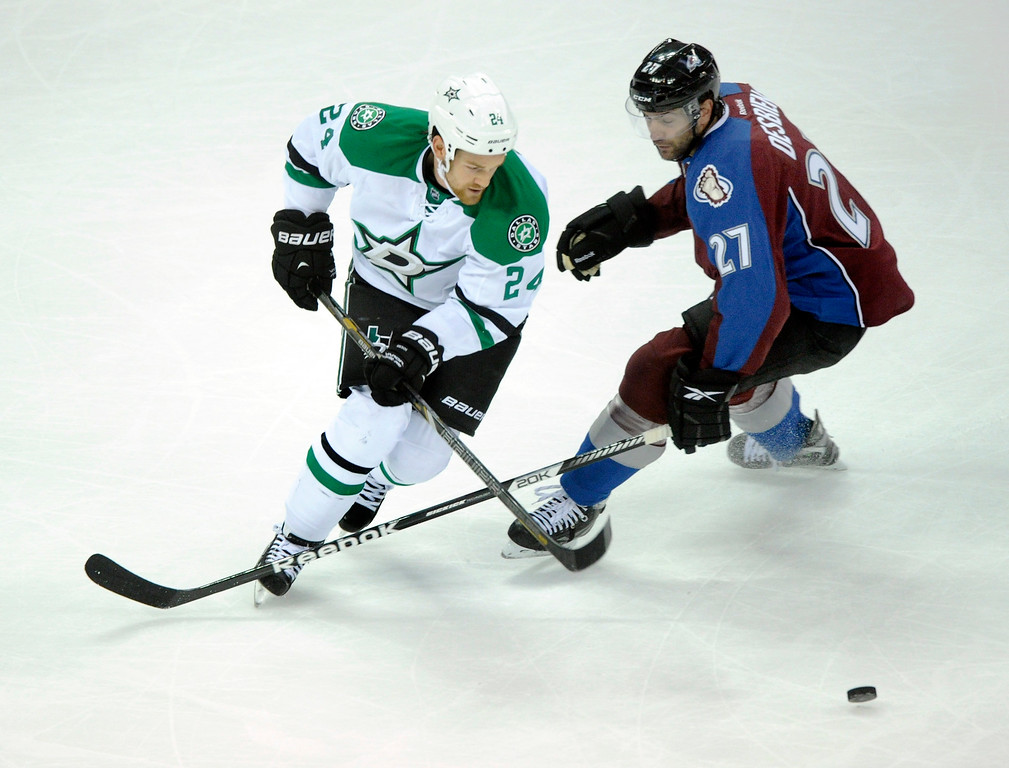 . Dallas center Jordie Benn (24) skated past Colorado wing Guillaume Desbiens (27) in the first period.   Photo By Karl Gehring/The Denver Post