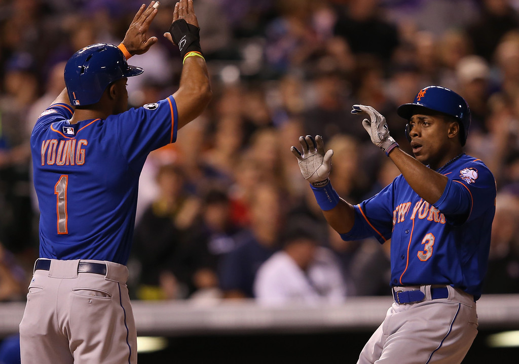 . DENVER, CO - MAY 02:  Curtis Granderson #3 of the New York Mets celebrates his two run home run off of starting pitcher Jorge De La Rosa #29 of the Colorado Rockies with Chris Young #1 of the New York Mets as they Rockies held a 7-3 lead in the sixth inning at Coors Field on May 2, 2014 in Denver, Colorado.  (Photo by Doug Pensinger/Getty Images)