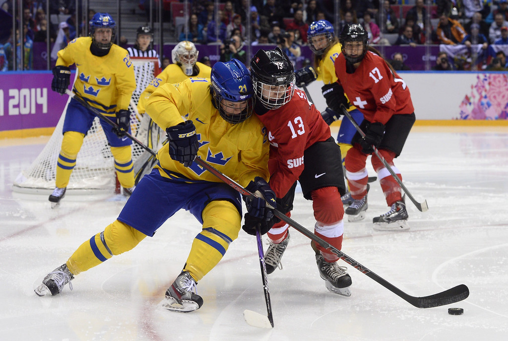 . Sweden\'s Erica Uden Johansson (L) vies with Switzerland\'s Sara Benz during the Women\'s Ice Hockey Bronze Medal Game Switzerland vs Sweden at the Bolshoy Ice Dome during the Sochi Winter Olympics on February 20, 2014. JONATHAN NACKSTRAND/AFP/Getty Images