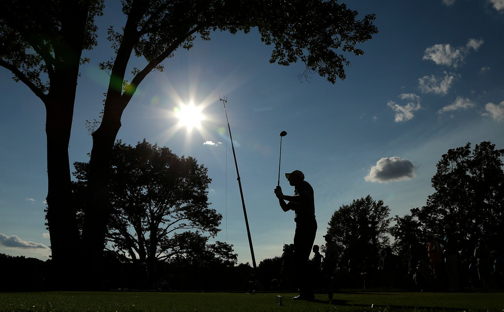 . Jim Furyk hits his tee shot on the 16th hole during the final round of the PGA Championship golf tournament at Oak Hill Country Club, Sunday, Aug. 11, 2013, in Pittsford, N.Y. (AP Photo/Charlie Riedel)