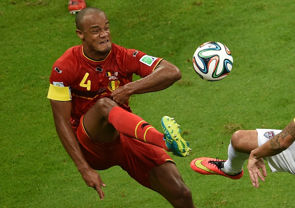 . Belgium\'s defender and captain Vincent Kompany plays the ball during a Round of 16 football match between Belgium and USA at Fonte Nova Arena in Salvador during the 2014 FIFA World Cup on July 1, 2014.     AFP PHOTO / PEDRO  UGARTE/AFP/Getty Images