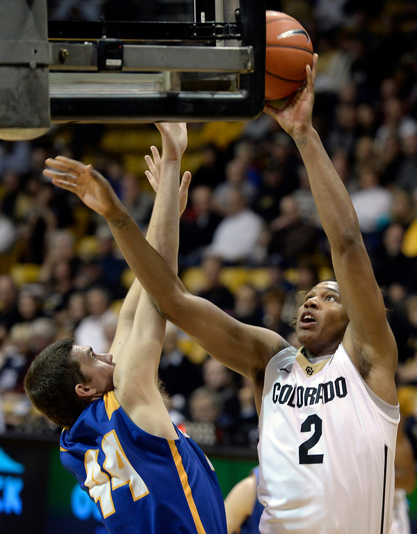 . University of Colorado\'s Xavier Johnson takes a shot over Sam Beeler during a game against  the University of California Santa Barbara, on Nov. 20, at the Coors Event Center in Boulder.  (Jeremy Papasso/Boulder Daily Camera)
