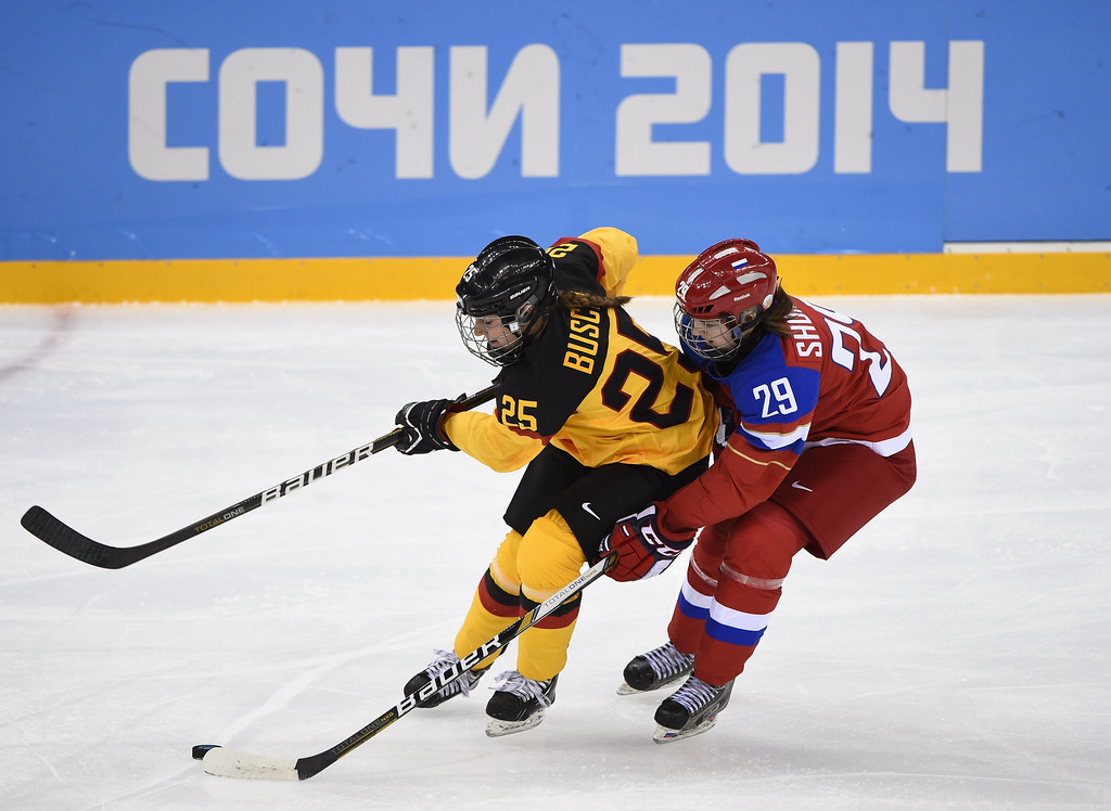 . Germany\'s Franziska Busch (L) vies with Russia\'s Anna Shokhina during the Women\'s Ice Hockey Group B match Russia vs Germany at the Shayba Arena during the Sochi Winter Olympics on February 9, 2014. JONATHAN NACKSTRAND/AFP/Getty Images