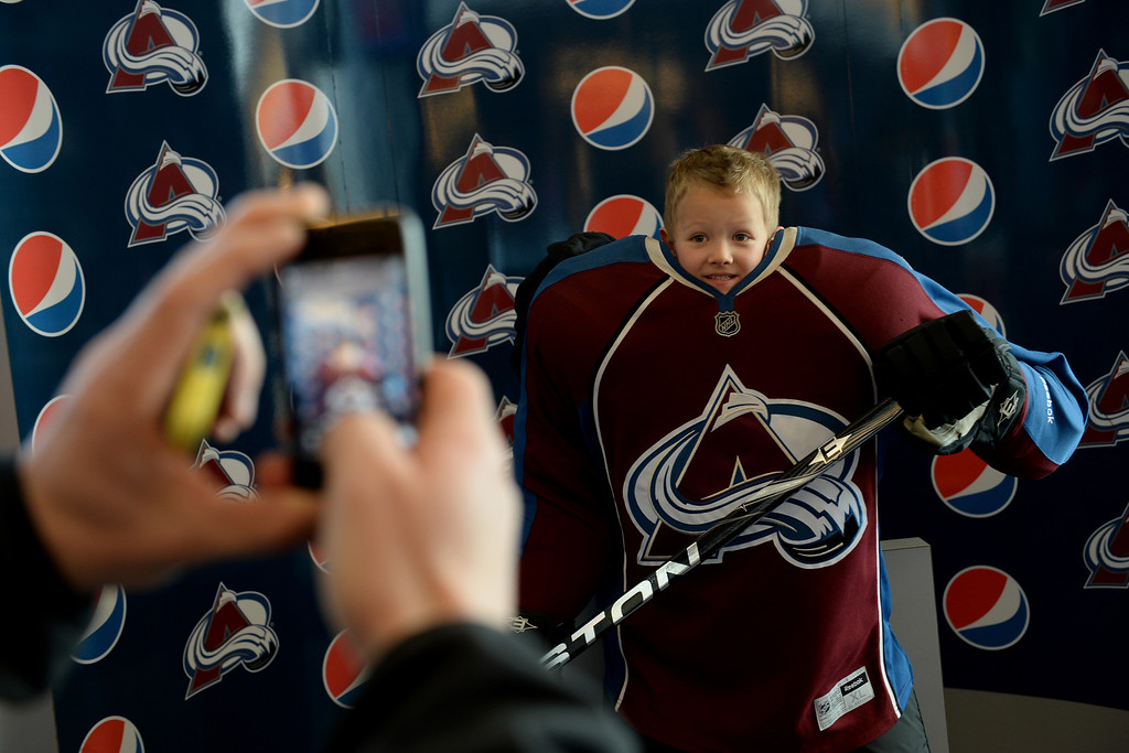 . Connor Rolland, 4, poses for a photo taken by his dad, Rob, before the first period of action. The Colorado Avalanche hosted the Minnesota Wild at the Pepsi Center on Thursday, April 17, 2014. (Photo by Karl Gehring/The Denver Post)