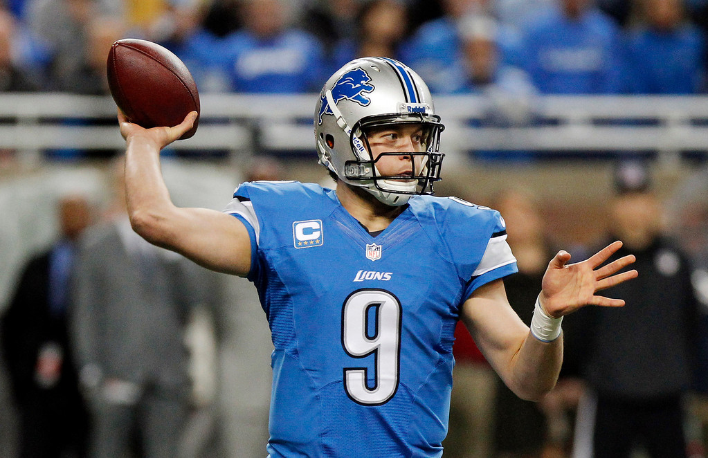 . Detroit Lions quarterback Matthew Stafford throws during the first quarter of an NFL football game against the Baltimore Ravens in Detroit, Monday, Dec. 16, 2013. (AP Photo/Duane Burleson)