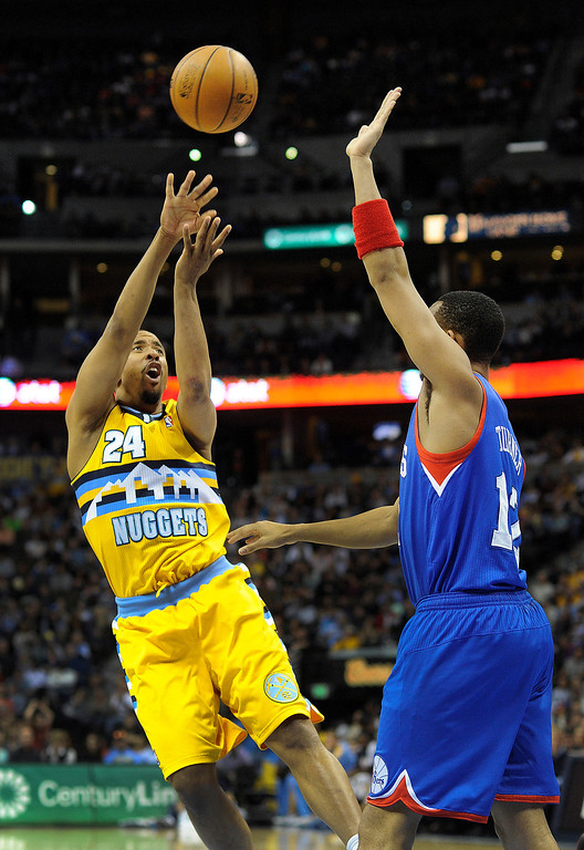 . DENVER, CO. - MARCH 21: Andre Miller (24) of the Denver Nuggets takes an off-balance shot over Evan Turner (12) of the Philadelphia 76ers in the second half. The Denver Nuggets defeated the Philadelphia 76ers 101-100 Thursday night, March 21, 2013 at the Pepsi Center. The Nuggets are on a 14-game record winning streak that is a team record. (Photo By Karl Gehring/The Denver Post)