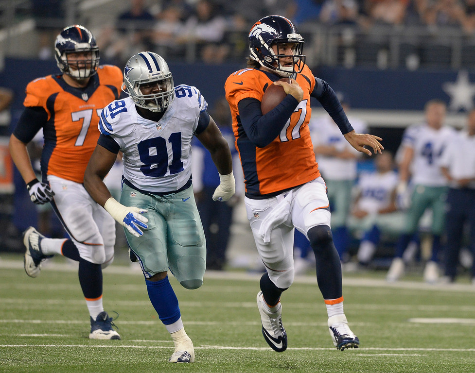 . ARLINGTON, TX - AUGUST 28: Denver Broncos quarterback Brock Osweiler (17) scrambles for a big gain as he gets chased by Dallas Cowboys defensive end Kenneth Boatright (91) during the third quarter August 28, 2014 at AT&T Stadium. (Photo by John Leyba/The Denver Post)