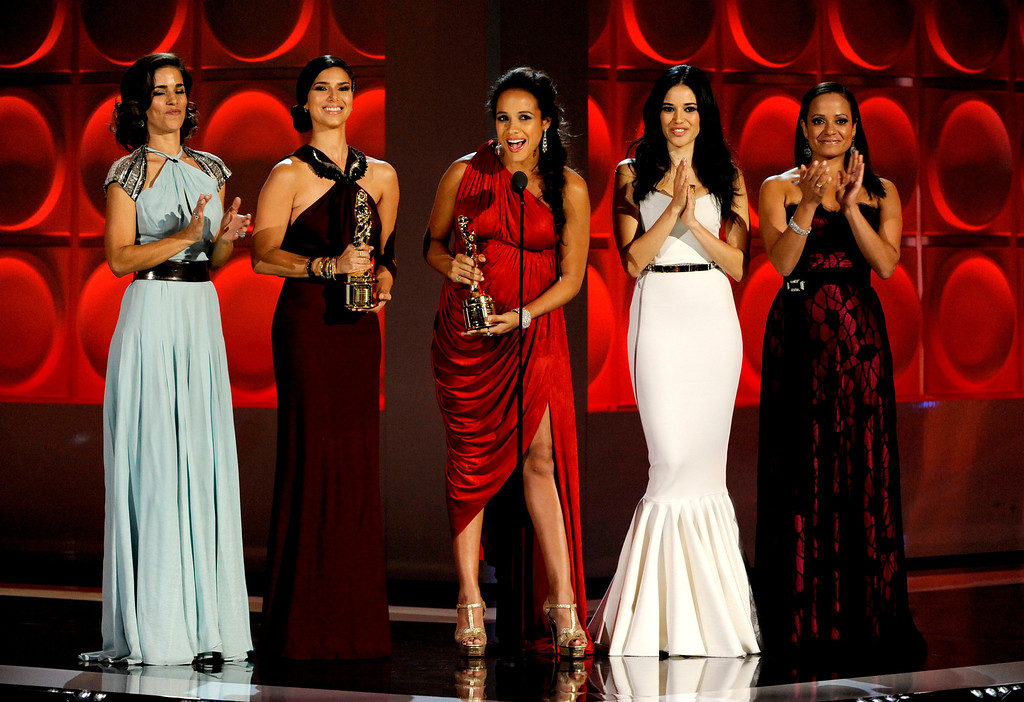 ". The cast of ""Devious Maids,\"" from left, Ana Ortiz, Roselyn Sanchez, Dania Ramirez, Edy Ganem and Judy Reyes, presents an award at the NCLR ALMA Awards at the Pasadena Civic Auditorium on Friday, Sept. 27, 2013, in Pasadena, Calif. (Photo by Paul Hebert/Invision/AP)"