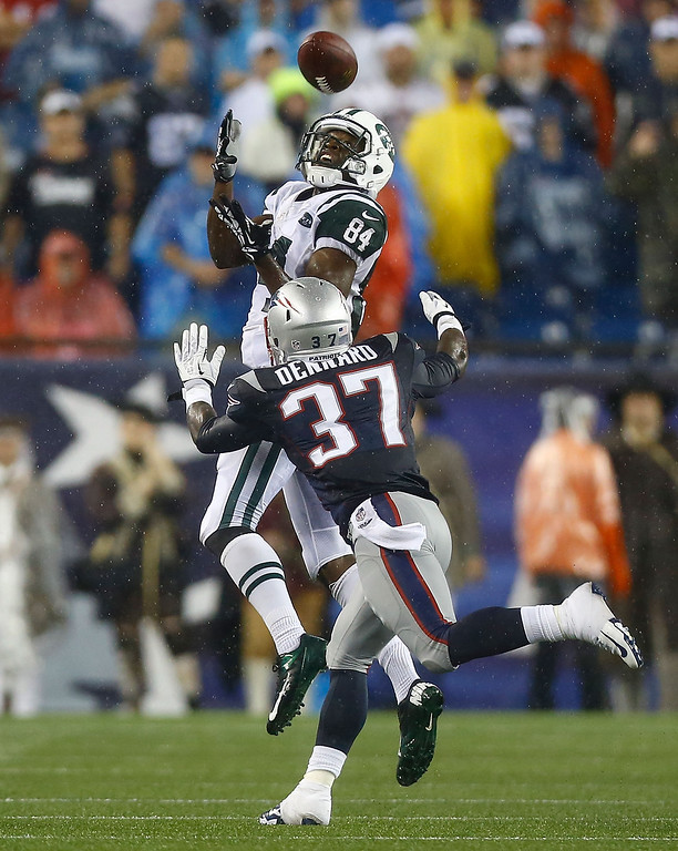 . Stephen Hill #84 of the New York Jets catches a pass over Alfonzo Dennard #37 of the New England Patriots in the second half during the game at Gillette Stadium on September 12, 2013 in Foxboro, Massachusetts. (Photo by Jared Wickerham/Getty Images)