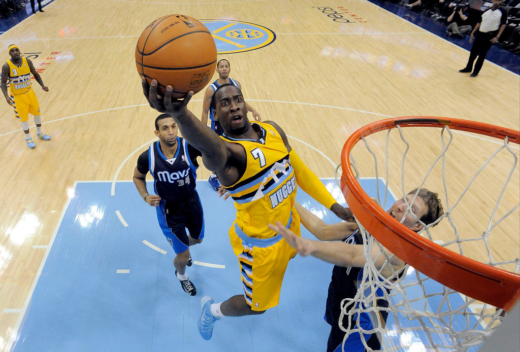 . Denver Nuggets center J.J. Hickson (7) goes up for an easy bucket pas Dallas Mavericks power forward Dirk Nowitzki (41) March 5, 2014 at Pepsi Center. Denver Nuggets defeated the Dallas Mavericks 115-110. (Photo by John Leyba/The Denver Post)
