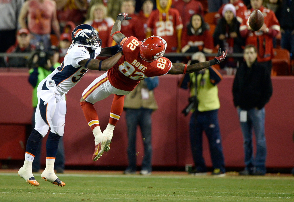 . KANSAS CITY, MO - DECEMBER 01: Denver Broncos cornerback Kayvon Webster (36) puts a push on Kansas City Chiefs wide receiver Dwayne Bowe (82) keeping him from catching the ball during the fourth quarter December 1, 2013 at Arrowhead Stadium.  (Photo by John Leyba/The Denver Post)