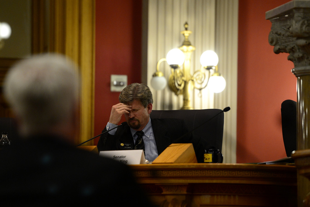 . DENVER, CO - MARCH 4: Sen. Steve King rubs his head as Sen. John Morse testifies against assault weapons at the State Capitol. Four gun bills were up for debate. (Photo by AAron Ontiveroz/The Denver Post)