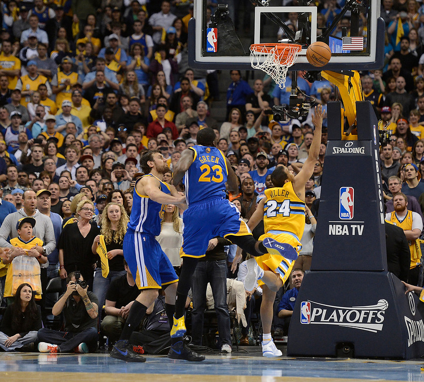 . DENVER, CO. - APRIL 20: Denver Nuggets point guard Andre Miller (24) drives to the basket for the game-winning shot in the fourth quarter. The Denver Nuggets took on the Golden State Warriors in Game 1 of the Western Conference First Round Series at the Pepsi Center in Denver, Colo. on April 20, 2013. (Photo by John Leyba/The Denver Post)