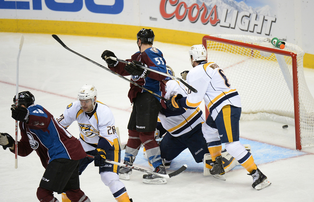 . DENVER, CO - OCTOBER 04 : Patrick Bordeleau of Colorado Avalanche (58) scores the goal from goalie Pekka Rinne of Nashville Predators (35) in the 2nd period of the game at Pepsi Center. Denver, Colorado. October 4, 2013. (Photo by Hyoung Chang/The Denver Post)